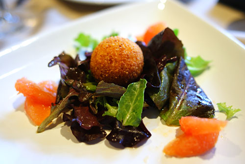 Panko Crusted Goat Cheese, on a bed of Organic Mixed Greens with a Red Grapefruit Vinaigrette