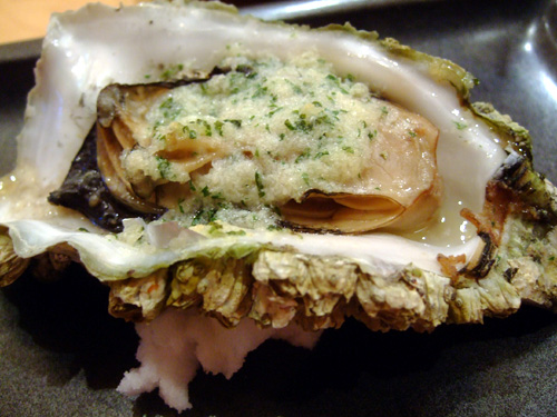 Charcoal Grilled Oysters topped with Garlic Butter
