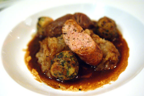 Braised Pork Cheek and Caraway Sausage with Sauerkraut, Pretzel Dumplings and Beer Sauce