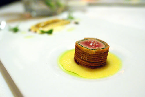 Potato Wrapped Tuna Wellington with Caponata Ravioli and Sauce Béarnaise