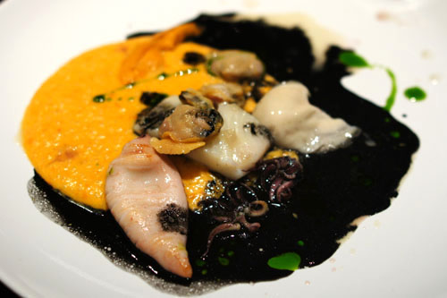 fuck bp. uni 'polenta'. squid. uni. oyster. fluke. mussel. clam. squid ink dashi 'sludge'. parsley oil. clam mussel juice reduction.