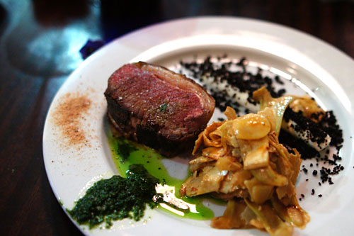 Roasted Sonoma Saddle of Lamb, Goat Cheese, Candied Black Olive, Artichoke Salad, Mint Pesto