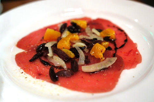 Ahi Tuna 'crudo' with black olive, fennel pollen, orange powder, chili