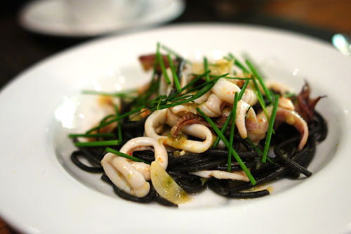 Seared Monterey calamari with squid ink linguini, jalapeno pesto, extra virgin olive oil