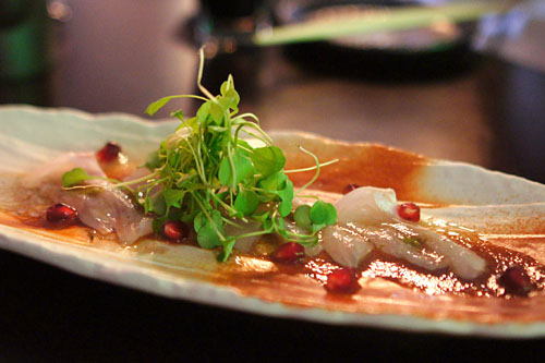 White fish sashimi with pomegranate