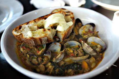house-made chorizo and braised clams, shell beans, black kale, grilled bread and aioli
