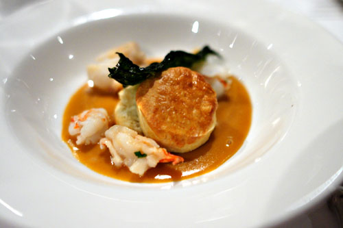 Lobster with biscuits, shellfish gravy, and fried kale