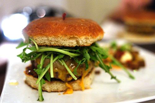 The PALADAR Burger: Angus Beef/ Cheddar Cheese/ Onion Jam/ Remoulade/ Wild Arugula/ Brioche Bun.