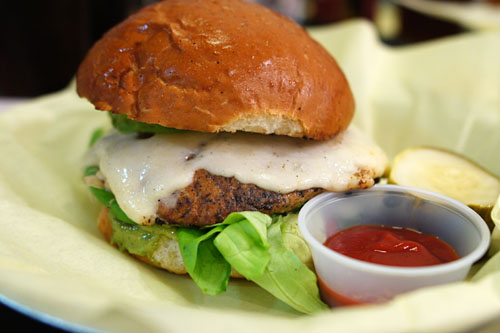O.C., turkey burger, herb sauce, sprouts, marinated carrots, avocado, provolone
