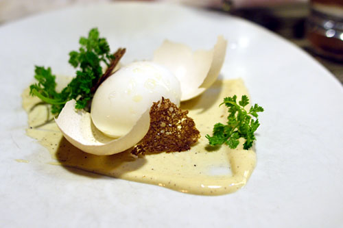 Poached egg in the shell, pumpernickel, caesar dressing, bean sprouts