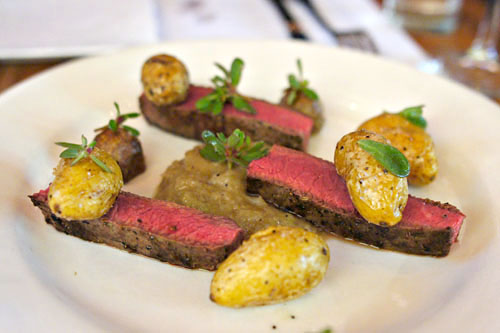 Flat iron steak, crispy pee wee potatoes & shallot/whiskey marmalade