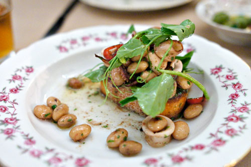 local squid, shelling beans, garlic, pea tendrils, grilled bread