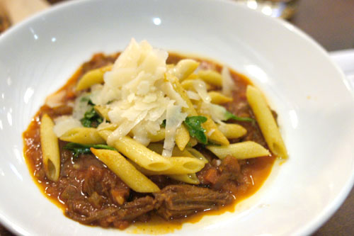 Oven Roasted Penne with Short Rib Bolognese, Arugula and Shaved Parmesan
