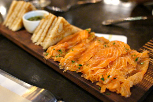 House Smoked Salmon, grilled toast, onion, caper, lemon