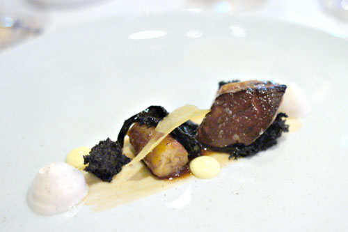 Seared Hudson Valley foie gras with banana flambé, sauce Hollandaise, Black Trumpet mushrooms, and warm brandy meringue
