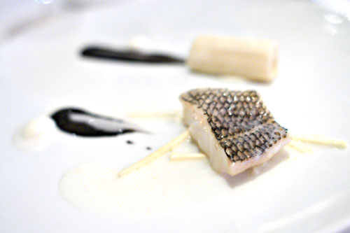 Black bass with hearts of palm 'cannelloni', black sesame, bitter almond and young coconut