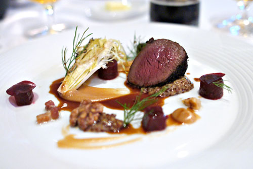 Rosemary-juniper crusted venison with date-tamarind purée, roasted beets, lardons, grilled winter greens and walnuts