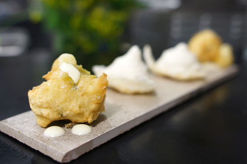 Seaweed beignet, yuzukosho and lime + Onion chicharron, smoked creme fraiche