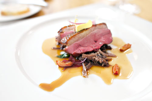 Pan Roasted Duck Breast with Forbidden Rice and Foie Gras 'Risotto,' Pickled Ramps, Duck Confit, Cherry Jus