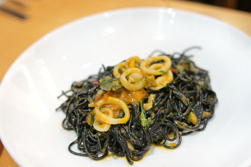 spaghettini nero, sea urchin, squid puttanesca & fried capers