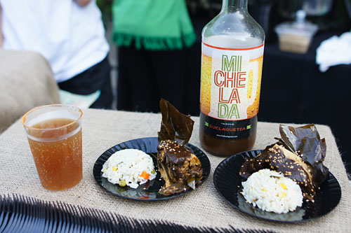 Tamales Oaxaqueños: Black Mole and Chicken Breast Tamales wrapped in Banana Leaf / Michelada