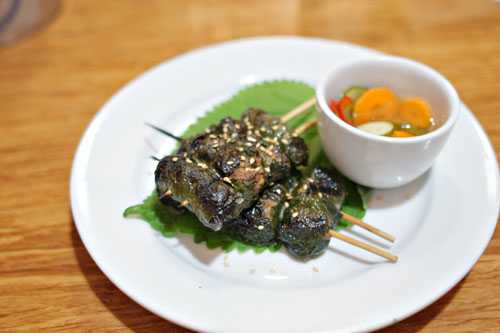Grilled beef wrapped in sesame leaves