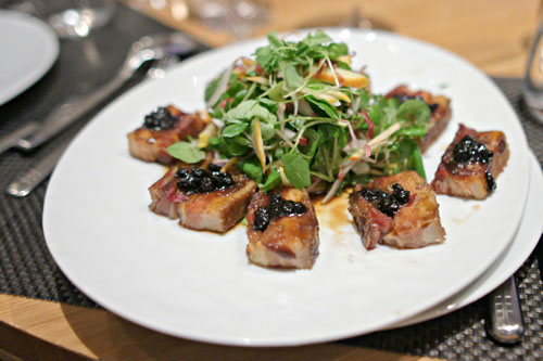 Maple Glazed Pork Belly, Asian Spices, Watercress, Sesame-Orange Dressing, Wild Huckleberry Compote