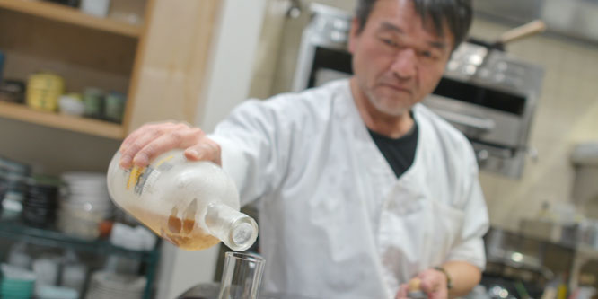 Yama-san Pouring Scotch