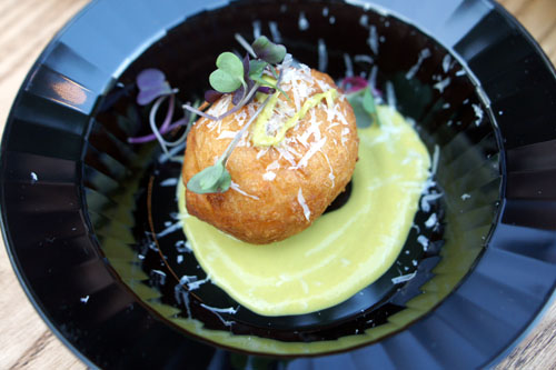 Yuquitas: Stuffed Yucca Beignets, Manchego Cheese, Grated Parmesan & Serrano Sauce