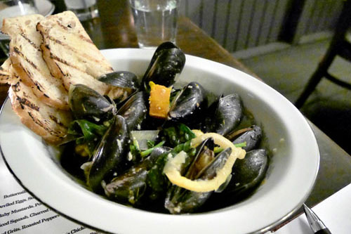 Mussels with Berbere Spiced Squash, Charred Leek, Bloomsdale Spinach & Meyer Lemon Confit