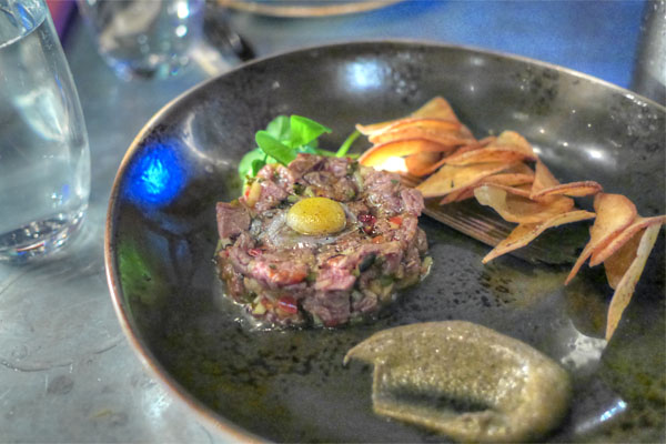 ma la beef tartare, pear, pine nuts, quail egg, bone marrow vin