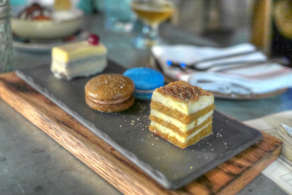 white chocolate tangerine mousse bar / french macaron of the moment / pumpkin spice mascarpone cake