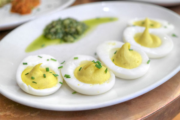 Deviled eggs with green sauce
