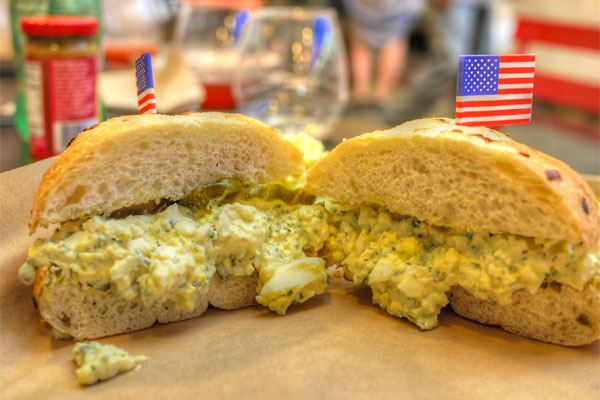 Ruskie, egg salad, pickles, Kaiser roll