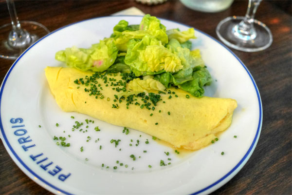 Omelette, chives, Boursin cheese, Boston lettuce, Dijon vinaigrette