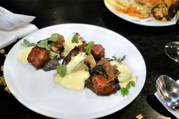 Roasted Cauliflower Hearts, Hatch Chile Hollandaise, Black Beans, Mexican Rice Cakes, Caramelized Onion, Cilantro