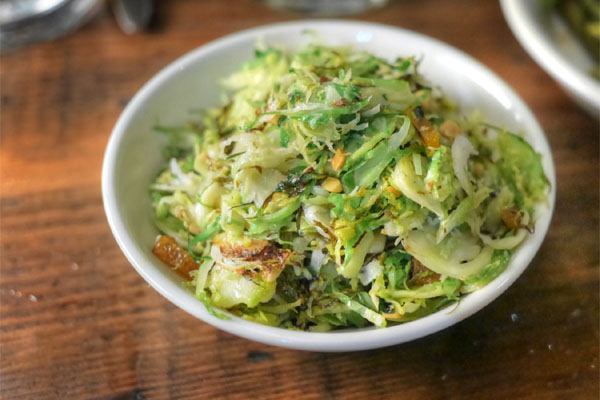 Shaved Brussels sprouts, roasted almond, caper, dried apricot salad