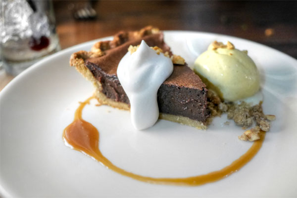 Chocolate pie, rye crust, Spanish peanut crumble, vanilla-malted ice cream