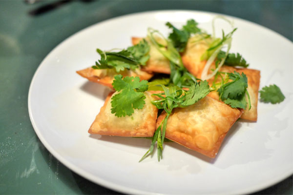 Fried four cheese ravioli / pesto herb salad