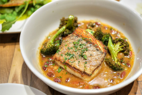 wild striped bass, rancho gordo beans, broccoli, tomato confit, sherry beef jus