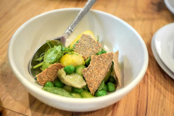 spring vegetables with lemon preserve, seed crackers and vadouvan