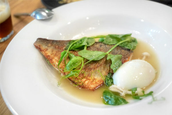 sea bream with jamon broth, slow poached egg, spring peas