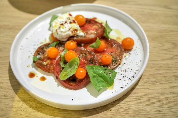heirloom tomatoes, burrata, basil & saba
