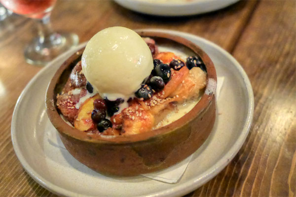 benne & peach bread pudding, blueberries, vanilla bean ice cream