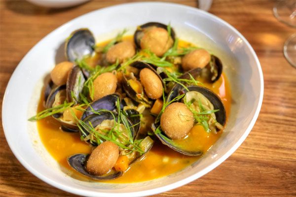 Savory Clams, Jan's Kimchi Broth, Butterkin Squash, Steam Bun Croutons, Scallion, Lemon