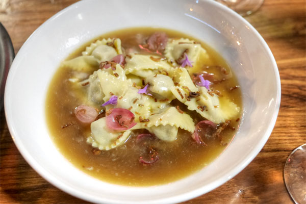Hillary's Short Rib & Mascarpone Cappelletti, Soubise, Onion Brodo, Pickled Pearl Onions, Crispy Shallots, Chive Blossoms