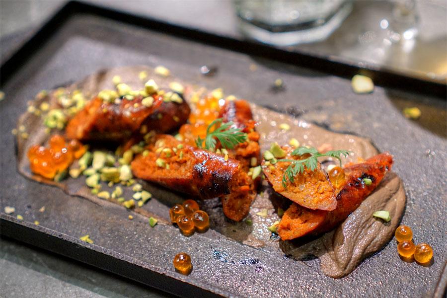 Homemade Chorizo, Mushroom Mousse, Pistachio, Carrot Tops, Salmon Roe