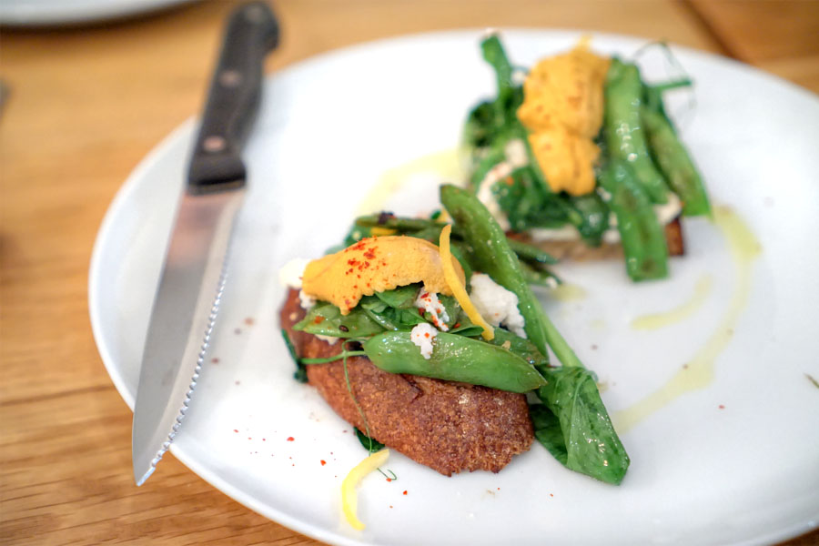 sea urchin toast with spring peas, ricotta, and preserved lemon