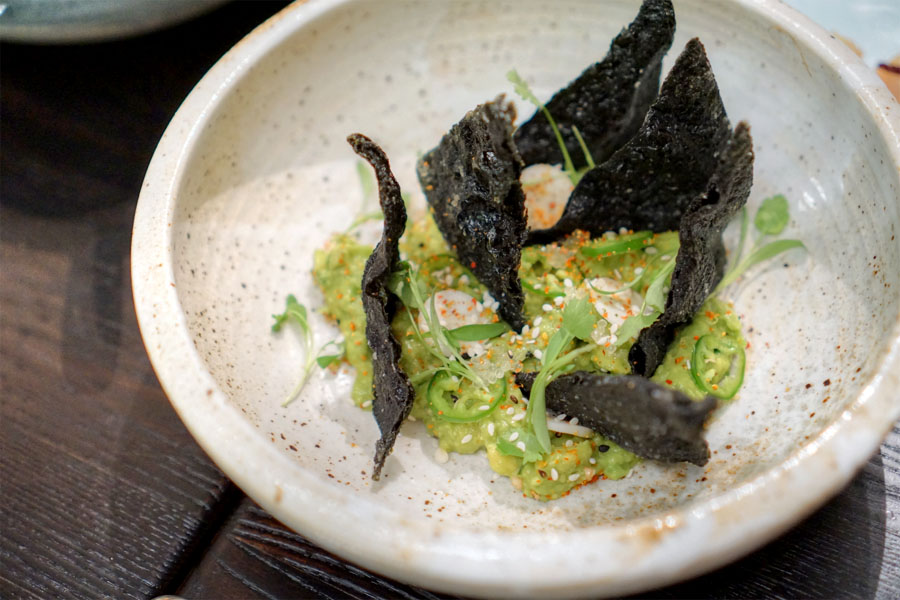 Seaweed 'dorito' with guacamole, togarashi and hearts of palm