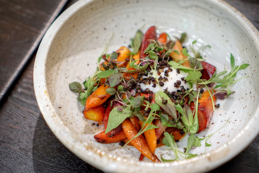 Roasted carrots with coconut, crispy lentils, Thai herbs and tamarind sriracha